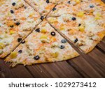 pizza with pineapple on a...   Shutterstock . vector #1029273412