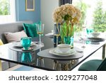 Small photo of eclectic and colorful tableware in green color scheme setting on marble dining table