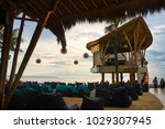 Small photo of CANGGU, BALI, INDONESIA - JANUARY, 2018: DJ-place at Finns Beach Club with people hanging around during the day