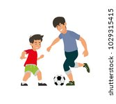 father and son play football.... | Shutterstock .eps vector #1029315415