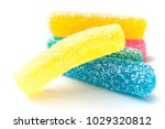 Small photo of closeup of traditional acidulated candies on white background