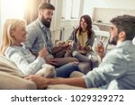 happy friends drinking wine and ... | Shutterstock . vector #1029329272