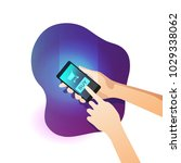 hand holding smart phone with...   Shutterstock .eps vector #1029338062