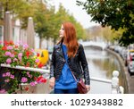 young redhead woman standing at ...   Shutterstock . vector #1029343882