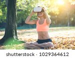 young woman practicing yoga in... | Shutterstock . vector #1029364612