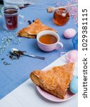apple turnovers served with tea ...   Shutterstock . vector #1029381115