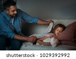 father covering sleeping... | Shutterstock . vector #1029392992