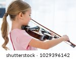 side view of cute little child... | Shutterstock . vector #1029396142
