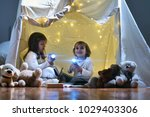 two little girls play at home... | Shutterstock . vector #1029403306