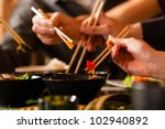 young people eating in a thai... | Shutterstock . vector #102940892