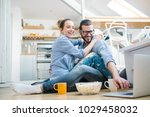 young couple watching movie on... | Shutterstock . vector #1029458032