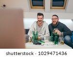 friends watching sport on tv at ... | Shutterstock . vector #1029471436