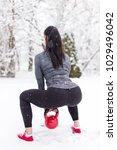 sporty woman doing butt... | Shutterstock . vector #1029496042