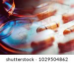 pills in test tube over blue... | Shutterstock . vector #1029504862