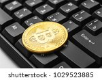 bitcoin on a computer keyboard  ... | Shutterstock . vector #1029523885