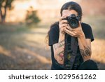 young photographer with long... | Shutterstock . vector #1029561262
