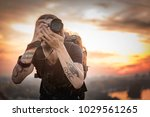 young photographer with long... | Shutterstock . vector #1029561265