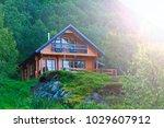 wooden house standing in the... | Shutterstock . vector #1029607912