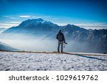 photographer in the alps | Shutterstock . vector #1029619762