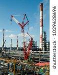 Small photo of jib crane machine withe sky background.construction scenery