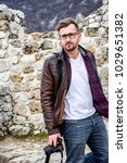 Small photo of Portrait of a handsome amateur photographer while traveling