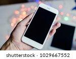 hand holding mobile smart phone ... | Shutterstock . vector #1029667552