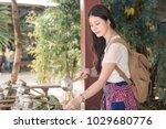 asian girl tourist tries the...   Shutterstock . vector #1029680776