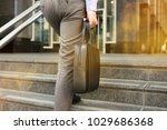 businessman walking and holding ... | Shutterstock . vector #1029686368