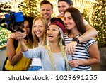 group of young adult friends... | Shutterstock . vector #1029691255