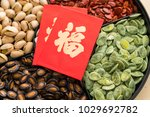 Small photo of Trdaitional chinese snack tray with red paket word mean luck