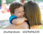 mother with the baby in park | Shutterstock . vector #1029696235