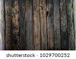 dark worn planked wooden...   Shutterstock . vector #1029700252