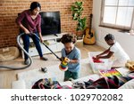 black family cleaning the house ... | Shutterstock . vector #1029702082