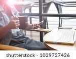 freelance woman using mobile... | Shutterstock . vector #1029727426