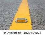 reflector on yellow line on... | Shutterstock . vector #1029764026