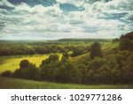 fields and meadows in a hilly...   Shutterstock . vector #1029771286