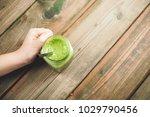 mason jar mug filled with green ... | Shutterstock . vector #1029790456