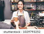 woman barista giving coffee cup ... | Shutterstock . vector #1029793252