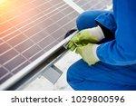 technician in blue suit... | Shutterstock . vector #1029800596