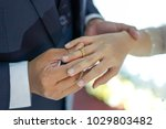 putting the wedding ring on... | Shutterstock . vector #1029803482