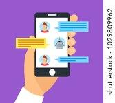 cartoon hand holding smartphone ... | Shutterstock .eps vector #1029809962