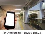 hand using smart phone isolated ... | Shutterstock . vector #1029818626