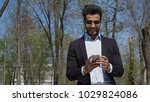 muslim guy clicking phone and... | Shutterstock . vector #1029824086