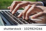 man uses laptop  clinking on... | Shutterstock . vector #1029824266