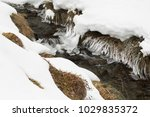 frozen alpine river covered... | Shutterstock . vector #1029835372