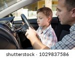 happy father and son sitting in ... | Shutterstock . vector #1029837586