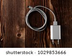 cable phone chargers on wood... | Shutterstock . vector #1029853666