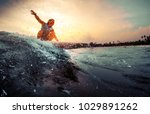 young surfer rides the wave... | Shutterstock . vector #1029891262