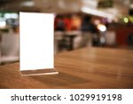 menu frame standing on wood... | Shutterstock . vector #1029919198