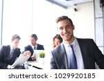 businessman with colleagues in... | Shutterstock . vector #1029920185